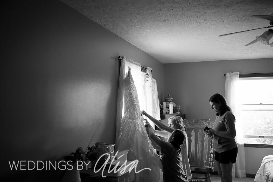 ironing bridal dress for wedding at St. Michael